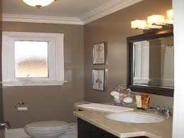 complete small space with dark vanity and white sink under wood framed mirror on grey bathroom