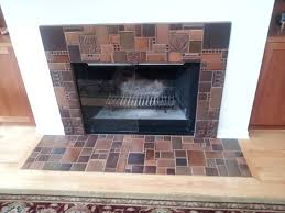 fun fireplace design with diffe colors and sizes of motawi tile