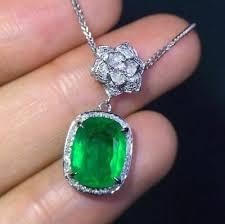 green oval emerald diamond halo pendant