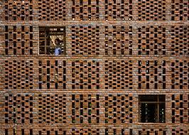 Perforated Brick Wall Design Pottery Studio Hides Elaborate Bamboo Shelving Grid Behind
