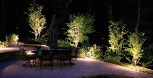 surrounded by soft landscape lighting for a romantic mood effect on this patio