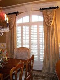 formal dining room curtains. #Windowtreatments Ring Curtains With Swags In Gold Silk Bead Trim, A Formal Dining Room N