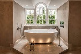bathroom inspiration. our stone one freestaning bath paired with dornbracht mem brassware. bathroom inspiration l