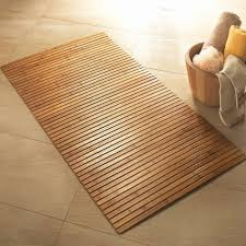 white bathroom with bamboo carpet plants fresh bamboo wooden bath mat wooden furniture