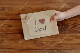 postcard made of cardboard and wrapping paper decorated with wooden heart waxed cord diy father s day or happy birthday card gift idea for daddy