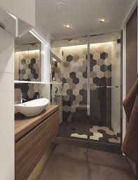 shower area with black grey and white hex tile mosaic