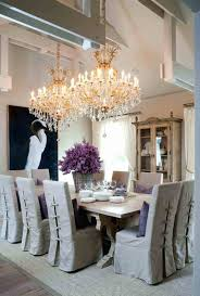 grand crystal chandelier cottage style dining room illuminated with double lights over concrete table regal