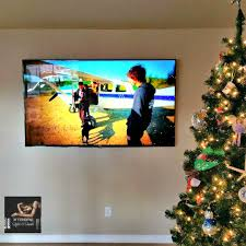 panel inspiration for tv wall mountill build a wood frame stretch 80 inch samsung led smart tv wall mounted equipment placed in closet on opposite wall wires hidden hook up to equipment extra long 4k rated hdmi cables