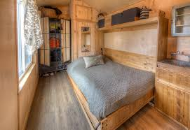 Small Picture Cool Rustic Tiny House Combines Chalkboard Wall and Murphy Bed