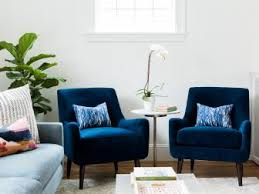 designing a living room space. sapphire blue armchairs meet metallic finishes designing a living room space