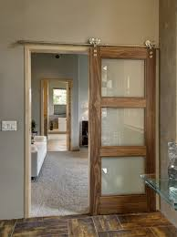 interior clear glass door. Modern Brown Sliding Barn Door With Clear Glass Details On Stainless Steel Rod Plus Smooth Grey Wall Theme And Parquet Wood Floor Interior