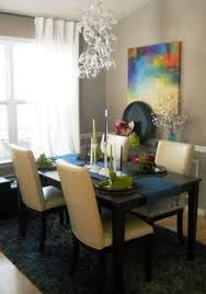 small dining room love the bright art and the wine gl chandelier