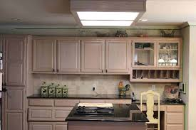 get grease off wooden kitchen cabinets preferable cleaning cabinet doors clean wood rhellenrennardcom unique cee table