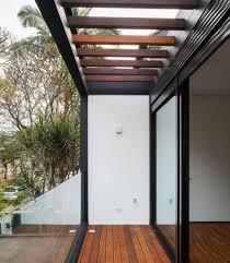 Wooden Pergola And Sliding Glass Panel Also Dark Steel Trusses ...