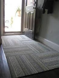 Modular FLOR carpet squares stay in place, are washable. For an entryway.