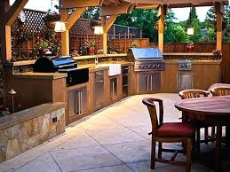 outdoor kitchen cabinets stainless steel brown kitchen cabinets with two grilling utensils and kitchen sink and stainless steel drawers on stainless steel