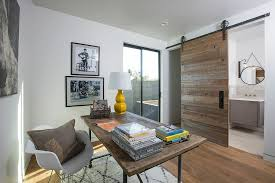 view in gallery sliding barn door separates the home office from the small bathroom from southland building