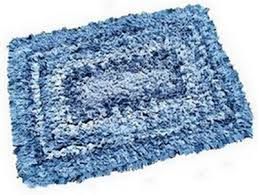 slightly frayed and faded denim rug after washing and drying
