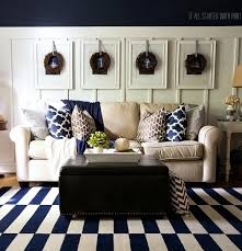 if you love the nautical look take inspiration from this living room that includes a striped navy and white carpet and hanging nautical ilrations