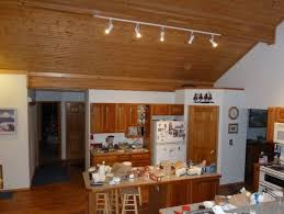 the worktop is another place for experimentation with kitchen track lights the led panels or led lamps will help suspended integrated lighting will best