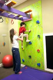 baby rock climbing wall rock climbing wall for toddlers a climbing wall with monkey bars above baby rock climbing wall