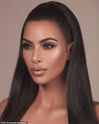 gorgeous kim kardashian was back to business as she promoted her latest makeup collection for