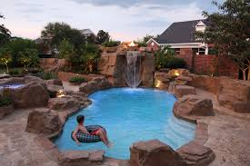 inground fiberglass swimming pool by royal fiberglass pools a viking pools trilogy pools company rico rock waterfall retaining wall and spa