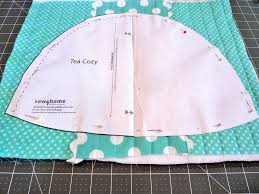 Pretty Tea Cozy | Sew4Home & Place it on a quilted panel, carefully lining up the center of the pattern  with the center vertical quilting line. Pin the pattern in place on the  panel. Adamdwight.com