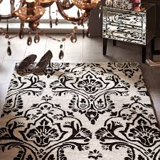 damask rug in black ivory hover to zoom