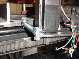 spring tensioned rack and pinion to reduce backlash