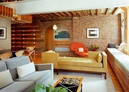 the brick living room furniture. Living Room Exposed Bricks Wall Corner Gray Sofa Yellow Brown And White Long Bench Pendant The Brick Furniture