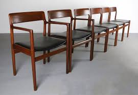 danish mondern johannes norgaard teak dining chairs with bold black upholstery a set of 6