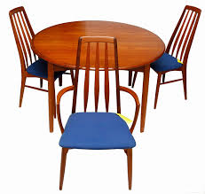 set of four danish teak eva dining chairs and round danish modern rosewood dining table