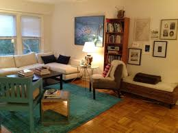 exciting living room design with overdyed rugs ikea and parquet flooring also sofa and bookshelves
