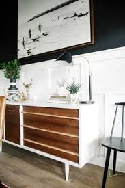 black dining room with white tulip table mixed dining room chairs one room challenge