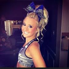 i d sports until my mom enrolled me in cheer now i couldn t be happier cute uniforms makeup fixing my long hair into a pretty style
