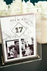 free printable table numbers that hold a photo of the bride and groom at each age