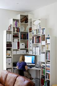 office area in living room. With Contemporary Storage Units You Can Make Good Use Of A Corner Space. Office Area In Living Room