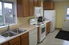 kitchen with range microwave and refrigerator