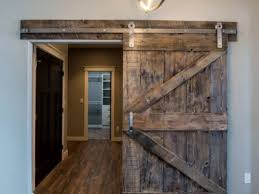 grey wash reclaimed wood sliding barn door with stainless steel hardware