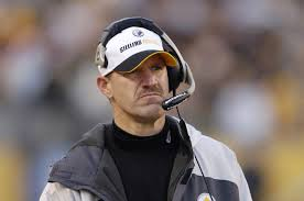 motorola nfl headset. bill cowher stands on the sidelines and listens to his headset. motorola nfl headset \