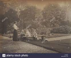 Ethel May Hickman and three children in the garden of Penn Court Stock  Photo - Alamy
