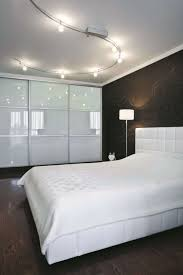 track lighting for bedroom. Minimalist Modern Bedroom With Track Lighting Fixtures Over The Bed White Bedding For
