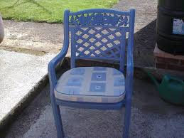 three blue plastic garden chairs with seat covers