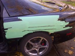 fixing and painting deep scratches and key marks in rear of car