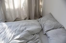 dehei light gray bedding remodelista 1