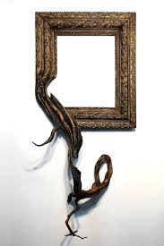 new fusion frames by darryl fuse gnarled tree roots with ornate picture frames colossal