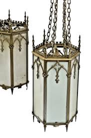 one of two matching all original massive ornamental cast iron metallic silver finish gothic style lutheran church interior light fixtures