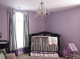 kids room purple wall theme and purple white striped curtains on the hook added by