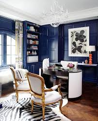 chic home office. blue lacquered walls a zebraprint rug and antique armchairs mingle in this swanky home office by fun house furnishings u0026 design chic